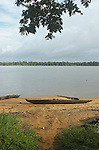 The Marowijne River, Suriname.  Abandoned dugout canoe on the beach near the village of Bigeston.