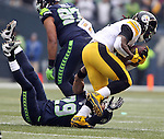 Pittsburgh Steelers running back DeAngelo Williams (34) puts Seattle Seahawks free safety Earl Thomas (29) on his back at CenturyLink Field in Seattle, Washington on November 29, 2015.  The Seahawks beat the Steelers 39-30.      ©2015. Jim Bryant Photo. All Rights Reserved.