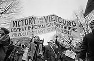 08 Apr 1969 --- Demonstrators in New York City protesting the Vietnam War, which as of this month has claimed more soldiers' lives than that of the entire Korean War. Last month, the United States began secret bombing campaigns of North Vietnamese and Vietcong bases in Cambodia. <br /> New York City, NY. 8 avril 1969. <br /> Les hippies manifestent contre l&rsquo;escalade de la guerre au Vietnam. Nixon est le premier vis&eacute;. De vraies t&ecirc;tes de cochons seront plant&eacute;es sur des piquets. Ce sera la seule fois o&ugrave; je verrai de vraies t&ecirc;tes de cochons utilis&eacute;es pendant des d&eacute;monstrations.