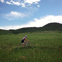 A lone mountain biker traverses North Table Mountain, a mesa in Golden, Colorado.