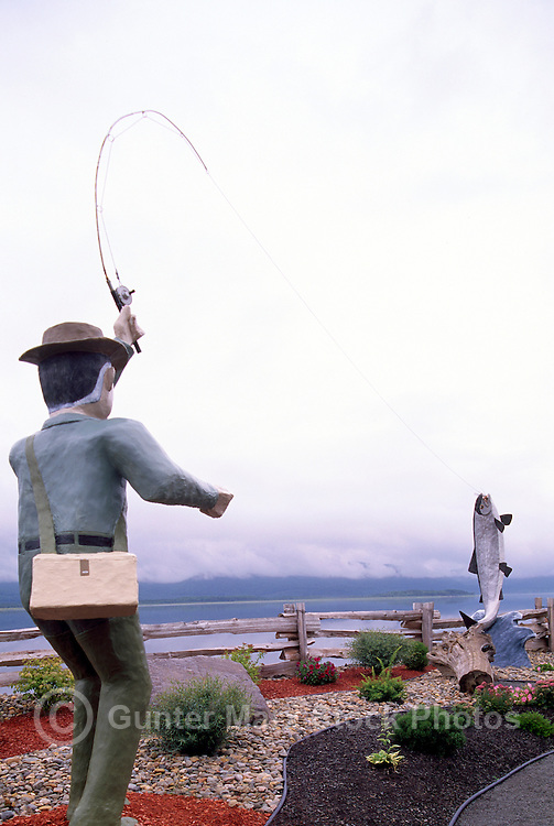 Campbellton, NB, New Brunswick, Canada - Large Wood Carving Sculptures of Sports Fisherman catching Atlantic Salmon