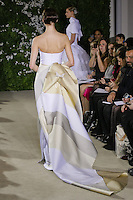 Model walks runway in an Emily wedding dresses by Carolina Herrera, for the Carolina Herrera Bridal Spring 2012 runway show.