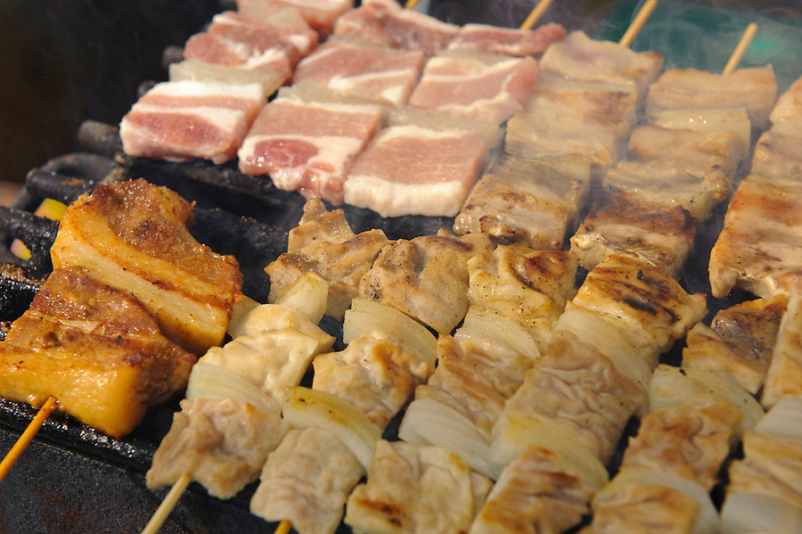 """A pork kebab stall, B1 Grand Prix, Yokote, Akita Pref, Japan, September 19 2009. The B1 Grand Prix is a competition for inexpensive and tasty regional dishes from around Japan. The B stands for """"b-class gourmet"""". In 2009 it was held in the northern Japan city of Yokote."""