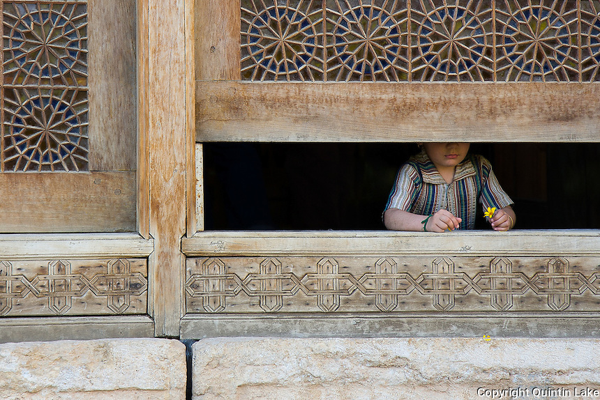 A girl at the window of The Arg (Citadel) of Karim Khan, Shiraz, Iran