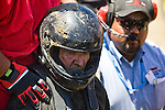 Dennis Reick after a wreck destroyed his car at the National Sand Drad Race Association's 2009 Summer Nationals in Avenal, CA May 17, 2009.