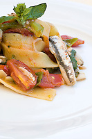 Detail of a plate of fettuccine with anchovies and  pomodorino piennolo del Vesuvio tomatoes at the restaurant La Torre del Saraceno, Vico Equense in Italy