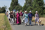 Bradwell on Sea Essex England. Pilgrimage to St Peters Chapel 2009. Banner is of St Cedd who founded Celtic style community and chapel here is 654AD.
