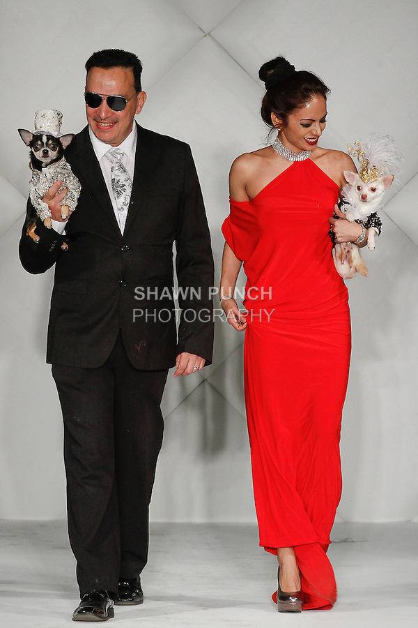 Canine couture designer Anthony Rubio of Bandit Rubio Designs, and womenswear designer Ivon Reyes, walk runway holding dog models for the close of the Bandit Rubio pet wear fashion show, during Fashion Week Brooklyn Fall Winter 2014, at Industry City, on March 15, 2014.