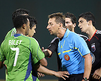 Pablo Hernandez #21 of D.C. United watches Fredy Montero #17 of Seattle Sounders FC as referee Alex Prus talks to him during an MLS match at RFK Stadium on July 15 2010, in Washington DC.Seattle won 1-0.