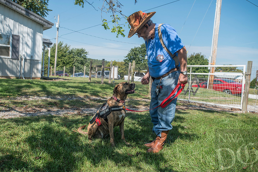 NWA Democrat-Gazette/ANTHONY REYES &bull; @NWATONYR<br /> Richard Ellett and his dog Tiger train Friday, Sept. 25, 2015 at the SoldierON service dog training facility in Fayetteville. Ellett was the first veteran to get a service dog through the program. He says the dog helps him to remember his medicine, aids him after a fall and helps with his PTSD.