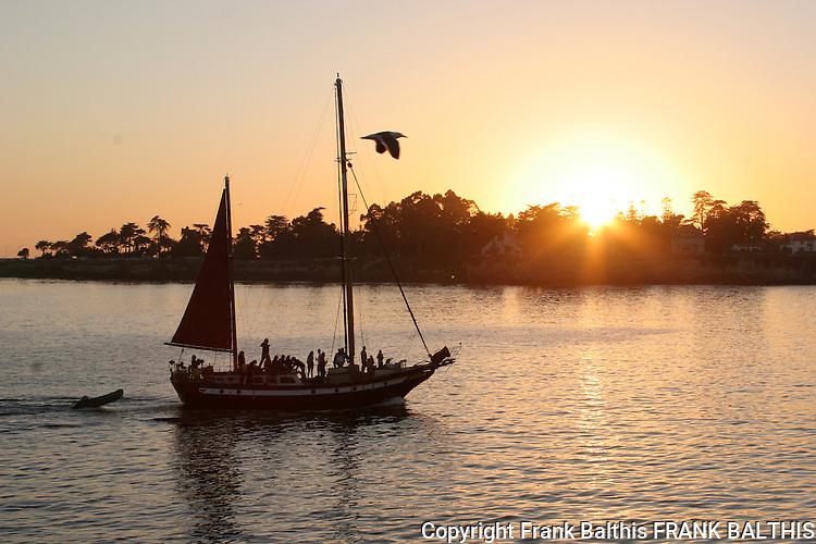 Sailing at sunset near wharf