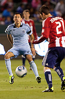 Sporting KC midfielder Davy Arnaud (22) stares down CD Chivas USA's Ben Zemanski (21). Sporting KC defeated CD Chivas USA 3-2 at Home Depot Center stadium in Carson, California on Saturday March 19, 2011...