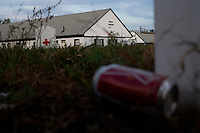 A discarded beer can lays on the ground in the land surrounding Motel Caswell in Tewksbury, Massachusetts, USA, on Tuesday, Oct. 11, 2011. The motel is owned by Russell Caswell. Caswell's father built the motel in the 1950s. Now, conservative activitists are trying to use federal asset-forfeiture laws to seize the motel, saying that the motel is used by drug dealers to conduct business.  The legal challenge intends to show evidence tying the property to crimes in order to seize the motel.....CREDIT: M. Scott Brauer for the Wall Street Journal.slug: FORFEIT