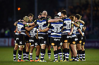 The Bath Rugby team huddle together at half-time. West Country Challenge Cup match, between Bath Rugby and Exeter Chiefs on October 10, 2015 at the Recreation Ground in Bath, England. Photo by: Patrick Khachfe / Onside Images