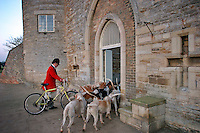 Cambridgeshire, England, 05/11/2003..The Fitzwilliam Hunt on their first meet of what may be the last legal hunting season in the UK, as Parliament moves to ban hunting with dogs..The huntsmen return the hounds to their lavish kennels at the end of the hunt.