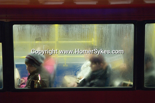 London transport bus commuters going home after work south London 2009