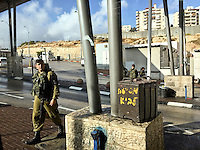8. &quot;Checkpoint&quot;: entrance to Jerusalem.<br /> <br /> While we stop momentarily at this security checkpoint, a young male soldier strides past our vehicle. He looks toward us, but pays us no mind. As visiting Americans, we'll be waved through without further ado. Not so for the many others who must often navigate this passage.
