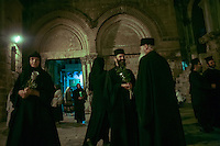 Christian Orthodox clergymen and nuns holding candles and flowers gather at the Court of the Holy Sepulchre on August 25, 2013 before a religious procession marking the Dormition of the Theotokos (God-bearer) which commemorates the Virgin Mary. Thousands of Christian Orthodox clergy and pilgrims took part in the early morning procession, an annual event during which Orthodox believers carry an icon of the Virgin Mary from the Church of the Holy Sepulchre to Mary's Tomb Church, located on the foothills of the Mount of Olives, near Gethsemane garden, which is regarded as the burial place of Virgin, according to Christian tradition. Photo by Oren Nahshon