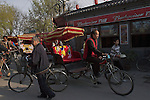 Rickshaws circle the Shichahai area near the Yinding Bridge in Beijing,China.