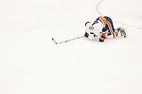 PITTSBURGH, PA - NOVEMBER 21:  Mark Eaton #4 of the New York Islanders lays on the ice after sustaining an injury against the Pittsburgh Penguins during the game on November 21, 2011 at CONSOL Energy Center in Pittsburgh, Pennsylvania.  (Photo by Jared Wickerham/Getty Images)