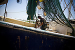 Fisherman Hung Tran, 42 loads the H&R shrimp boat at Dean Blanchard Seafood, Inc. in Grand Isle, LA on June 24, 2010 where a fishing ban has been put in place due to the B.P. oil spill. The H&R crew will head west in hopes to find open fishing waters after waiting two months for B.P. to hire their boat.