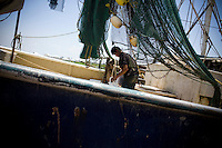 Fisherman Hung Tran, 42 loads the H&amp;R shrimp boat at Dean Blanchard Seafood, Inc. in Grand Isle, LA on June 24, 2010 where a fishing ban has been put in place due to the B.P. oil spill. The H&amp;R crew will head west in hopes to find open fishing waters after waiting two months for B.P. to hire their boat.