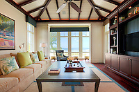 Relaxing sofa and chairs invite you in and the water view is the focal point