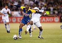 Mosqera Aquivaldo (left) battles for the ball against Lassana Diarra (right). Real Madrid defeated Club America 3-2 at Candlestick Park in San Francisco, California on August 4th, 2010.