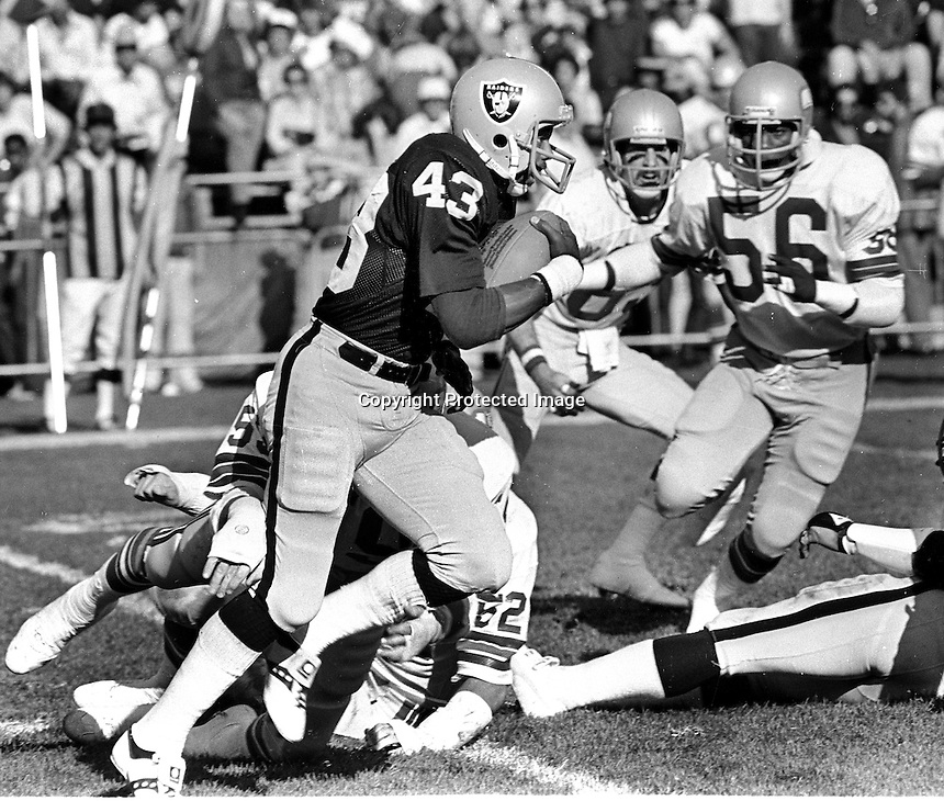 Raiders return man Ira Matthews #43 returns against the Seattle Seahawks..(1980 photo by Ron Riesterer)