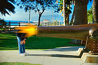 Woman looking into a Giant Canon Barrel Blast