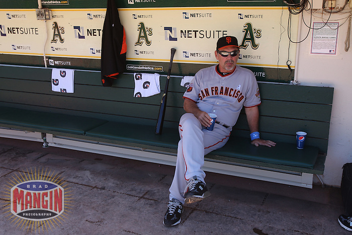OAKLAND, CA - JUNE 19:  Manager Bruce Bochy #15 of the San Francisco Giants sits in the dugout before the game against the Oakland Athletics at the Oakland-Alameda County Coliseum on June 19, 2011 in Oakland, California. Photo by Brad Mangin