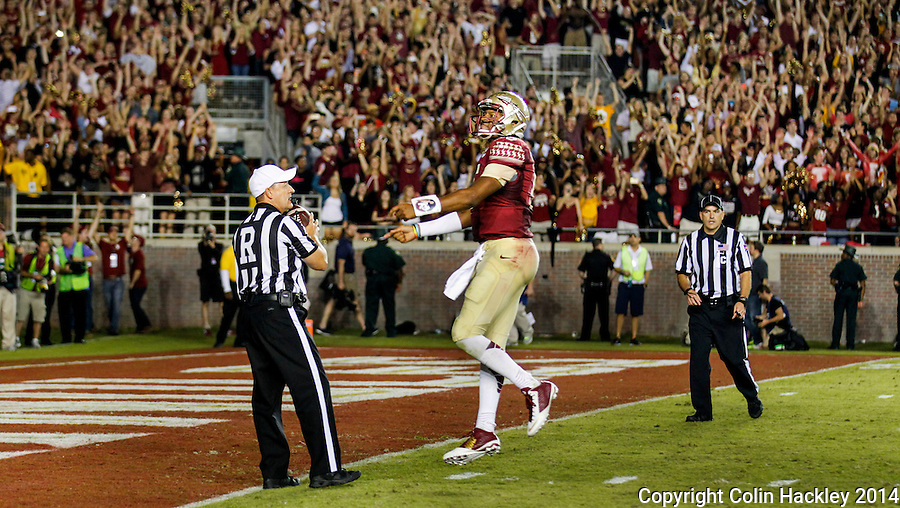 TALLAHASSEE, FLA. 10/18/14-FSU-ND101814CH-Florida State's Jameis Winston celebrates after beating Notre Dame 31-27 Saturday at Doak Campbell Stadium in Tallahassee. <br /> COLIN HACKLEY PHOTO