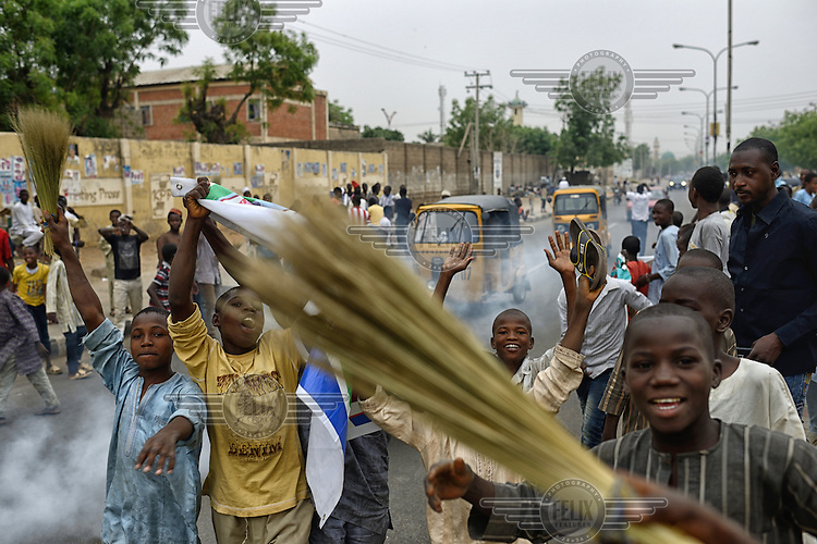Jubilant youths come onto the streets of Kano to celebrate the victory of Muhammadu Buhari, leader of the APC (All Progressives Congress Party), in the 2015 Nigerian Presidential elections.