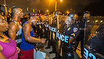 Protesters face off with Baton Rouge police in riot gear across the street from the police department over the Alton Sterling shooting in Baton Rouge, Louisiana July 8, 2016.  Sterling was shot and killed by police on July 5, 2016 in Baton Rouge, Louisiana. (Photo by Mark Wallheiser/Getty Images)