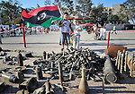 Months of fighting in Misrata, Libya, have left an abundance of ordnance scattered all over the city, some of which has been gathered by residents and placed in informal displays in front of buildings and in public spaces such as parks. Yet these informal museums include some extremely dangerous unexploded ordnance, and an ordnance disposal team from the ACT Alliance is working with local residents and city officials to neutralize the threat posed to civilians by the war debris. Here two boys examine the items on display in a Misrata square...