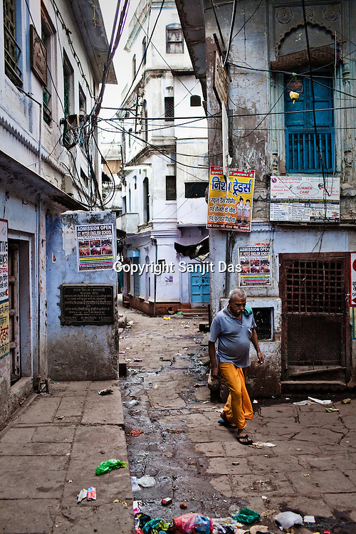 A man walks past the narrow alleys of the ancient city of Varanasi in Uttar Pradesh, India. Photograph: Sanjit Das/Panos