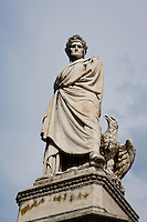 Low angle view of statue of Dante, 1865, by Enrico Pezzi, in the Piazza di Santa Croce, Florence, Tuscany, Italy, pictured on June 8, 2007, in the afternoon. Dante Alighieri, Italian poet, (1265-1321) wrote the Divine Comedy and was active in Florentine politics. Florence, capital of Tuscany, is world famous for its Renaissance art and architecture. Its historical centre was declared a UNESCO World Heritage Site in 1982. Picture by Manuel Cohen