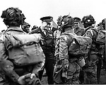 "In this image provided by the U.S. Army Signal Corps, General Dwight Eisenhower gives the order of the day, ""Full Victory - Nothing Else,"" to paratroopers somewhere in England just before they board their planes to participate in the first assault in the invasion of the continent of Europe, June 6, 1944.  (AP Photo/U.S. Army Signal Corps Photo)"
