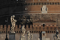 17th century statues of angels designed by Gian Lorenzo Bernini (1598-1680), Ponte Sant'Angelo, the bridge over the Tiber, which links the Castel Sant'angelo (in the background) to the Vatican City, 134 AD, Rome, Italy. Picture by Manuel Cohen