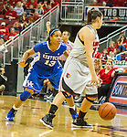 UK utilized a full court defense for the majority of the game against the Cardinals Sunday evening. Here UK sophomore guard Bria Goss applies pressure to Louisville freshman forward Cortnee Walton. in Louisville, Ky., on Sunday, December, 2, 2012. Photo by James Holt | Staff