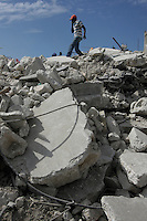 A man walks over the rubble of a building in downtown Port au Prince, Haiti, Jan. 26, 2010. (Australfoto/Douglas Engle)