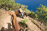 Hawaii: Molokai, the Mule Ride from the cliff tops down 1,600 feet to the leper colony at Kalaupapa.  Model released..Photo himolo144-72204.Photo copyright Lee Foster, www.fostertravel.com, lee@fostertravel.com, 510-549-2202