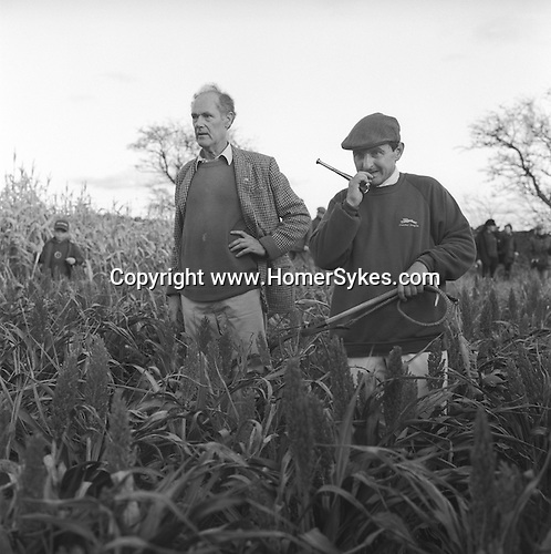 The Dummer Beagles..Steven Duckmanton with hunting horn and whip. It's unusual, but up to two and a half brace of hares have been culled in a day. Manor Farm, Upper Slaughter, Gloucestershire.Hunting with Hounds / Mansion Editions (isbn 0-9542233-1-4) copyright Homer Sykes. +44 (0) 20-8542-7083. < www.mansioneditions.com >.