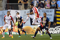 Alvaro Rey (23) of Toronto FC plays the ball during the first half against the Philadelphia Union during a Major League Soccer (MLS) match at PPL Park in Chester, PA, on October 5, 2013.