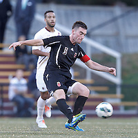 Brown University defender Ryan McDuff (5) passes the ball. Brown University (black) defeated Boston College (white), 1-0, at Newton Campus Field, October 16, 2012.