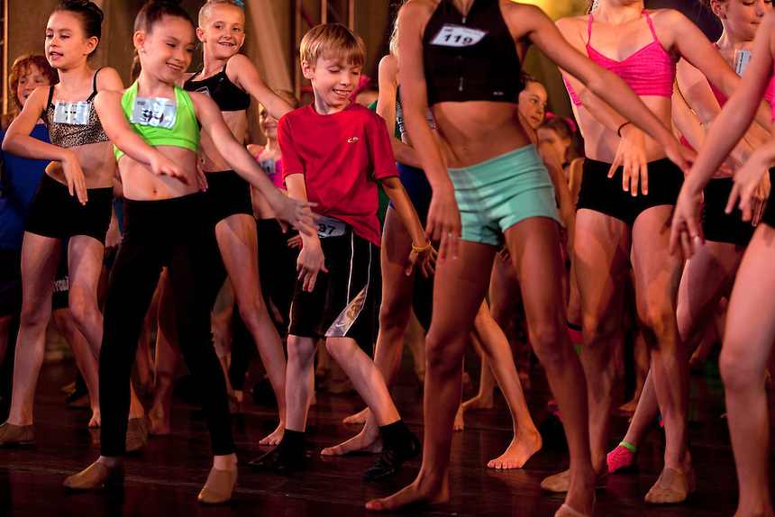 New York, NY - July 05, 2013 : Luke Spring, 10, center, dances during rehearsals for the Junior Gala at the New York City Dance Alliance National Summer Workshop held at the Sheraton New York Times Square Hotel in New York, NY on July 05, 2013. Luke Spring, a dance prodigy from Studio Bleu Dance Center in Ashburn, VA, has performed on the Tonys, Ellen, So You Think You Can Dance and The Ford Gala. His sisters Cami Spring, 20, and Lucy Spring, 18, are both award winning dancers. (Photo by Melanie Burford/Prime for The Washington Post)