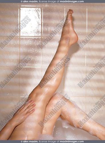 Legs of a woman taking a bath