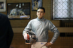 11 February 2017: Duke's Duncan De Caire waits for his turn to compete in Saber. The Duke University Blue Devils hosted the Massachusetts Institute of Technology Engineers at Card Gym in Durham, North Carolina in a 2017 College Men's Fencing match. Duke won the dual match 19-8 overall, 7-2 Foil, 6-3 Epee, and 6-3 Saber.