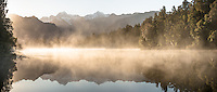 Reflections of Southern Alps in Lake Matheson at sunrise, Westland Tai Poutini National Park, West Coast, South Westland, UNESCO World Heritage Area, New Zealand, NZ