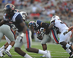 Ole Miss' Korvic Neat (28) is tackled by Southern Illinois' Bryan Presume (39) at Vaught-Hemingway Stadium in Oxford, Miss. on Saturday, September 10, 2011. Ole Miss won 42-24.